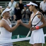 Melanie Oudin and Ana Ivanovic shake hands at the net after Ana's 6-0 6-1 victory